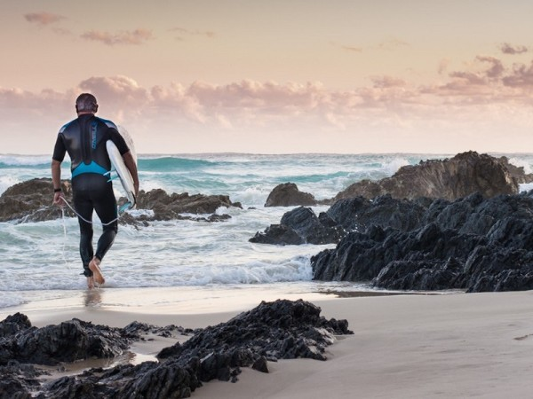 Sunrise with surfer at Byron Bay